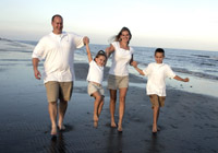 Family portraits on Pirates Beach in Galveston, Texas.