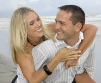 Engagement portraits on Pirates Beach in Galveston, Texas.