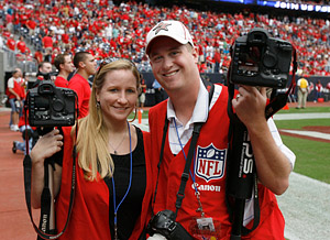 Ashley Cox and Kevin M. Cox on the field photographing the Houston Texans vs. Jacksonville Jaguars game on Sunday afternoon September 27, 2009 at Reliant Stadium in Houston.